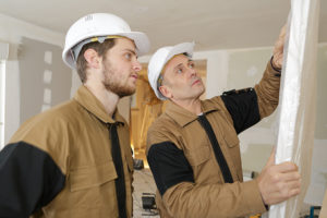 Constructor and apprentice verifies correct installation on gara